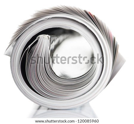 Magazine rolled up on white background with reflection