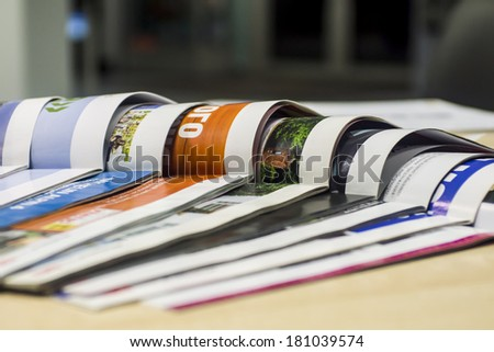 magazine spread in the office, in the background and the reception office - stock photo