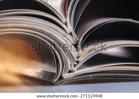 Magazine. Stack of opened magazines - stock photo