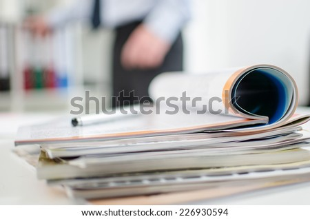 Magazines on a desk, closeup - stock photo
