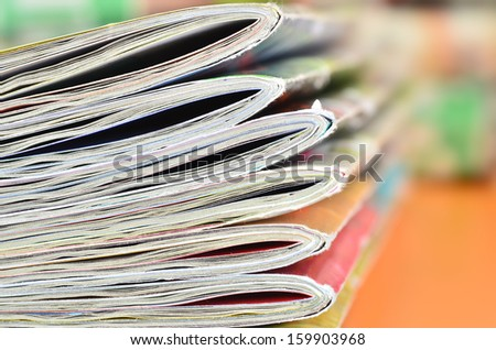 Magazines  on foreground edge - stock photo