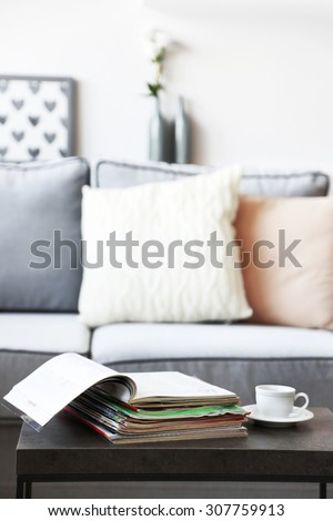 Magazines on table in living room, close up