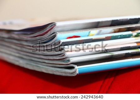 Magazines on the red sofa