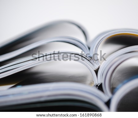 Magazines stacked in shallow focus - stock photo