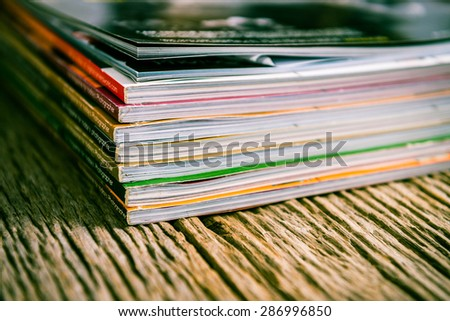 magazines up close on old wood - stock photo
