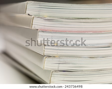 magazines with selective focus on edges - stock photo