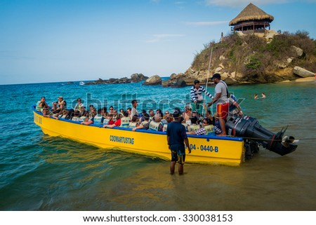 MAGDALENA, COLOMBIA - FEBRUARY 20, 2015: Tourists going on a boat tour in Tayrona National Park, protected area in the caribbean region of Colombia