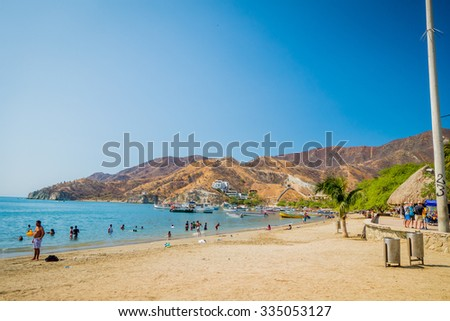 MAGDALENA, COLOMBIA - FEBRUARY 20, 2015: Unknown tourists enjoying Taganga beach in Santa Marta, Colombia