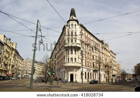 MAGDEBURG, GERMANY - APRIL 3, 2016. Residential/commercial building on Hasselbachplatz, the corner of Breiter Weg and Otto-von-Guericke-strasse in Magdeburg, across tram tracks, with street view.