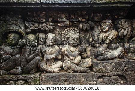 MAGELANG, INDONESIA - DECEMBER 20: bas-relief in ancient buddhist temple Borobudur on 20 december, 2013 in Magelang. Borobudur is the biggest and most visited buddist temple in Indonesia - stock photo