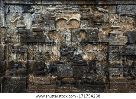MAGELANG, INDONESIA - DECEMBER 20: bas-relief in ancient buddhist temple Borobudur on 20 december, 2013 in Magelang. Borobudur is the biggest and most visited buddist temple in Indonesia