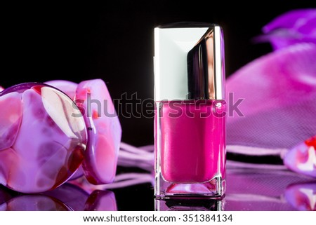 magenta nail polish on  background of women's accessories