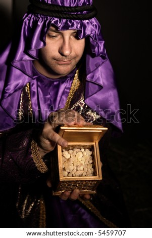 Magi with a  golden box filled with Frankincense.   Frankincense is the hardened resin of the Boswellia tree. This is frankincense from Omani which is said to be the best in the world. - stock photo