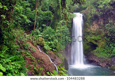 Magia Blanca waterfall in Costa Rica cascades in a lush, tropical setting. - stock photo