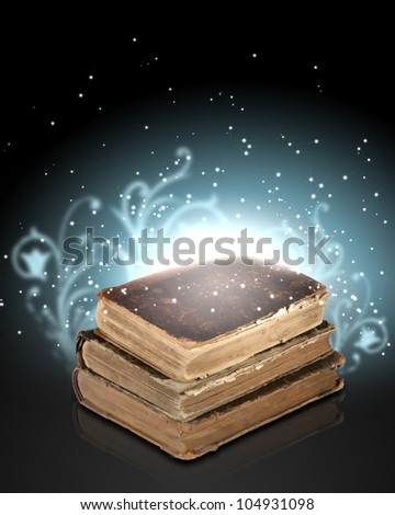 Magic book with light coming from inside it - stock photo