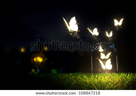 magic butterfly take off from glass jar - stock photo