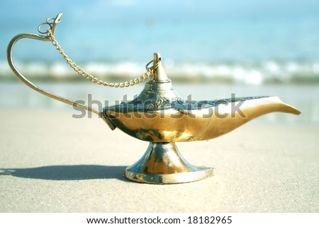 Magic genies lamp on seashor - stock photo