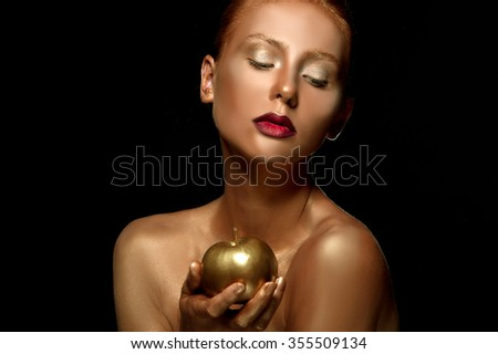 Magic Girl Portrait. Golden Makeup.Beautiful gold girl. Amazing woman with a gold skin. Face art - stock photo