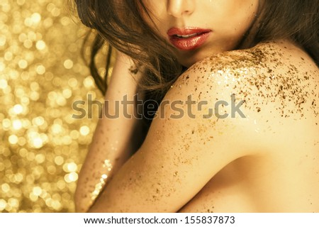 Magic Girl Portrait in Gold. Golden Makeup