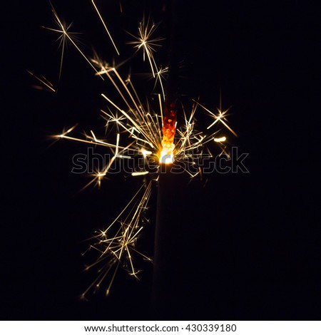 Magic glowing Flow of fire Sparks on black background - stock photo