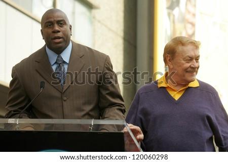Magic Johnson and Jerry Buss at the Ceremony Honoring Los Angeles Lakers Owner Jerry Buss with the 2,323rd star on the Hollywood Walk of Fame. Hollywood Boulevard, Hollywood, CA. 10-30-06 - stock photo