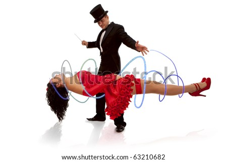 Magic moment - man performing magically levitating his assistant on white background - stock photo