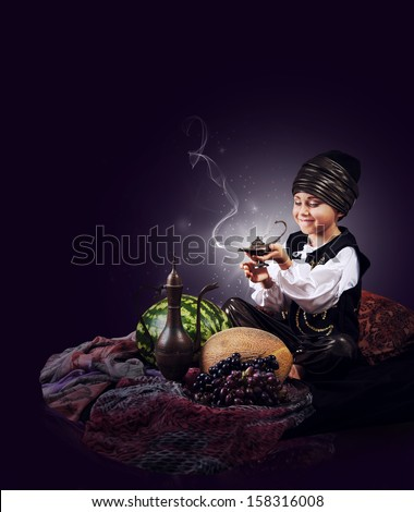Magic scene : little boy causes of gin from old Lamp - stock photo