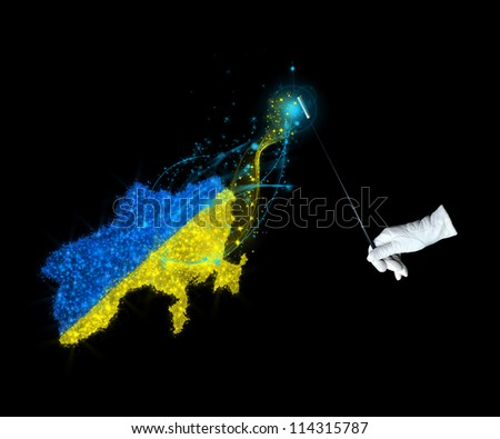 Magic wand and the Ukrainian flag on a black background