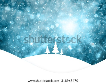 Magical blue colored sky with realistic heavy snowfall and sparkle, Christmas and New Years Holiday winter landscape scene with trees on hills. Illustration greeting card with copy space background. - stock photo
