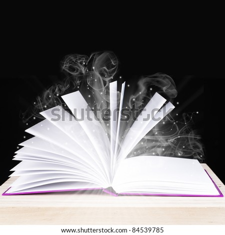 magical book on a black background - stock photo
