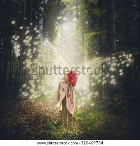 Magical butterfly creature in the forest  - stock photo