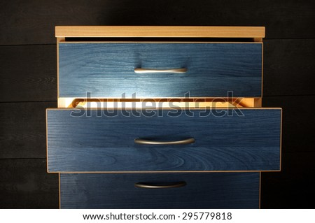 Magical light from drawer - stock photo