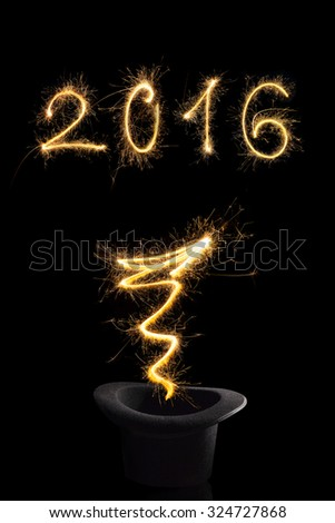 Magical new year. Magical fireworks from black top hat forming 2016 and abstract light lines isolated on black background. Happy new year background. - stock photo
