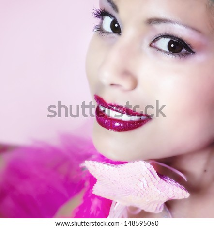 Magical smile and lips/  Beautiful woman's face with heavy lipstick smiling holding a wand. - stock photo