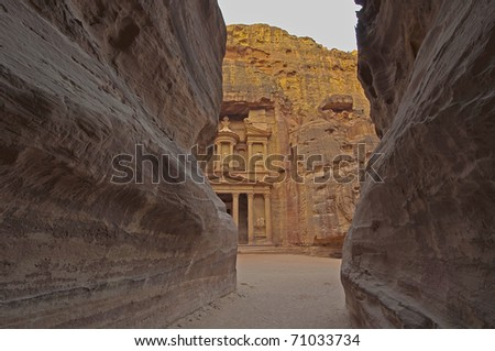 Magical sunrise from the Siq (canyon) on El Khazneh (The Treasury). Petra, Jordan.