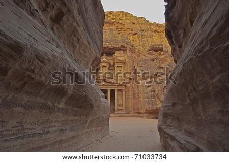 Magical sunrise from the Siq (canyon) on El Khazneh (The Treasury). Petra, Jordan. - stock photo