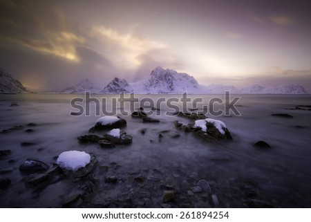 Magical sunset over Lofoten islands, Norway in winter  - stock photo
