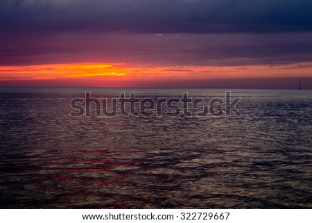 Magical sunset over the Adriatic sea with a boat