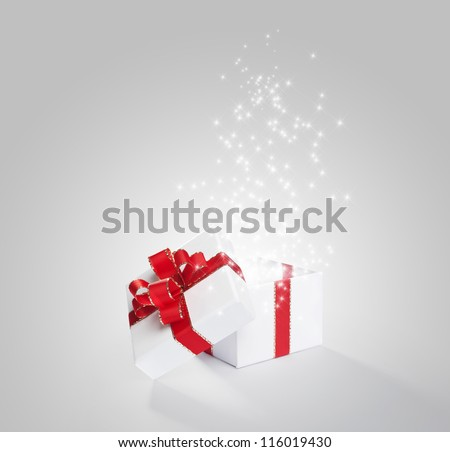 Magical white gift with red ribbon and bow - stock photo