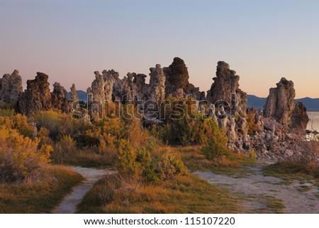 Magically beautiful sunrise. Sunrise at Mono Lake in the crater of an ancient extinct volcano. Shallow lake, a multitude of picturesque reefs Tufa - stock photo