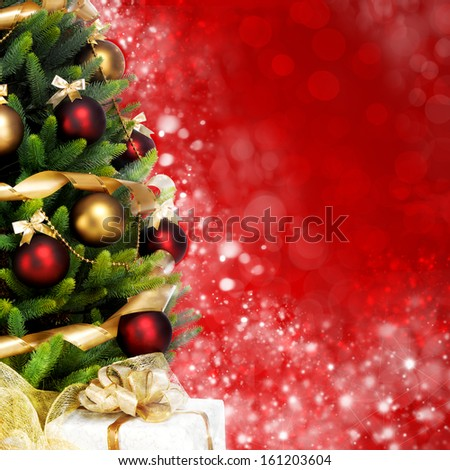 Magically decorated Fir Tree with balls, ribbons and garlands on a blurred Christmas-red shiny, fairy and sparkling background - stock photo