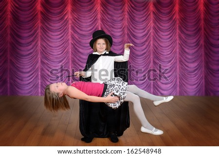 magician levitating assistant on a stage - stock photo