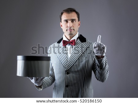 Magician showing tricks with a striped box