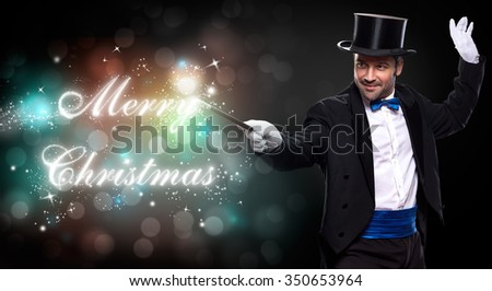 magician with a Christmas magic, trick for Merry Christmas - stock photo