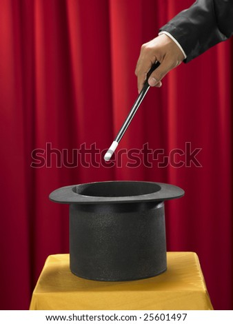 magician with the stick in front of top hat