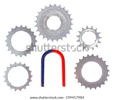 Magnet and metal gears isolated on white  - stock photo