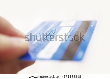 Magnetic Bank Credit Card in a Hand Isolated on White. Credit Card Reverse. - stock photo