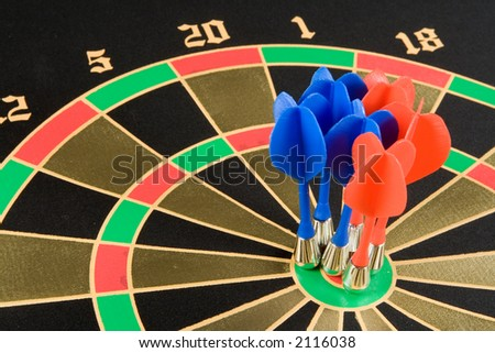 Magnetic darts in a target - stock photo