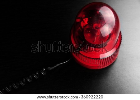 Magnetic Mounted Red Vehicle Police Strobe Rotating Flash Warning Light Beacon Flashing Emergency Lights On Black Background, Top View - stock photo