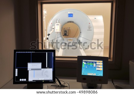 Magnetic Resonance Imaging machine from control room - a series of MRI.